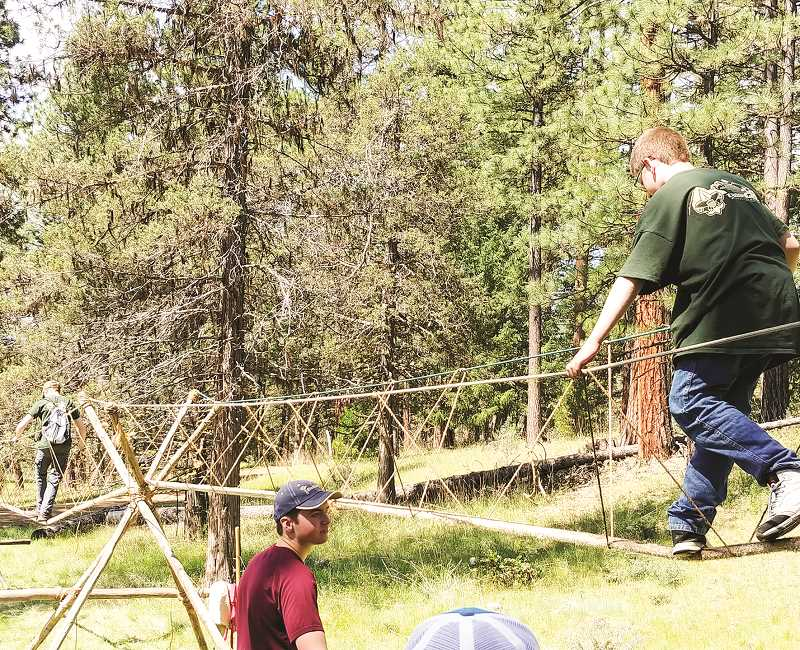 PHOTO COURTESY OF CHRIS BELZ - Boy Scouts walk across a monkey bridge, one of many activities visitors will be able to try during Scout-O-Rama. The local Scout Troop 28 will host the event in Prineville later this month.