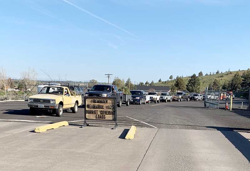 SUBMITTED PHOTO - Vehicles line up to drop off yard debris during the FireFree Community Cleanup at Box Canyon Transfer Station.