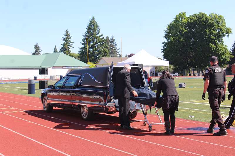 KRISTEN WOHLERS - One student is loaded into a hearse.