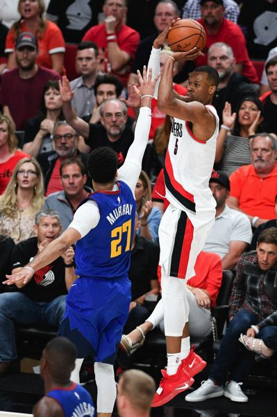 PMG PHOTO: CHRISTOPHER OERTELL - Rodney Hood of the Trail Blazers goes up over Denver Nuggets guard Jamal Murray on the way to 25 points.