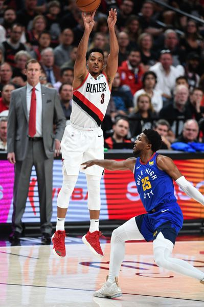 PMG PHOTO: CHRISTOPHER OERTELL - CJ McCollum of the Trail Blazers gets a shot off easily against Malik Beasley of the Denver Nuggets.