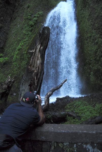 PMG PHOTO: MATT DEBOW  - Marciano Reichel takes a photo of Wahkeena Falls on Tuesday, May 7.