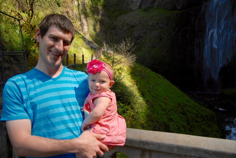 PMG PHOTO: MATT DEBOW  - Chad Hollinger holds his 10-month-old daughter Ellie at Benson Bridge at Multnomah Falls on Tuesday afternoon, May 7.