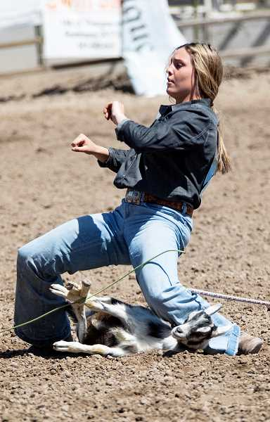 LON AUSTIN/CENTRAL OREGONIAN - Kennedy Buckner stands up after tying her goat Saturday during the first go round of the Tri-County Rodeo. Buckner won the round with a time of 6.62 seconds.