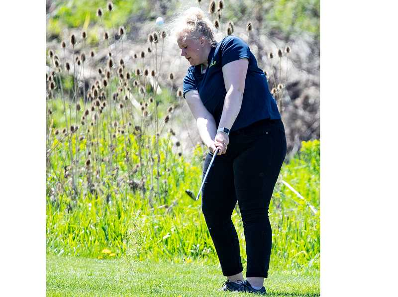 LON AUSTIN/CENTRAL OREGONIAN - Crook County golfer Jaylyn Smith chips onto the 18th green during the first day of the district tournament. Smith finished with a two-day total of 232.