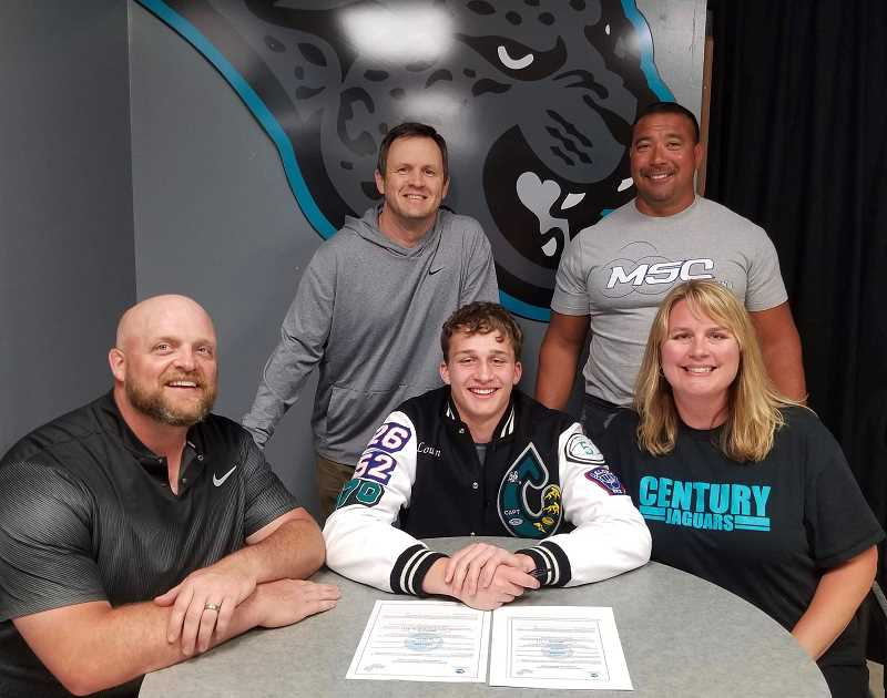 COURTESY PHOTO - Century's Loudyn Reese signs his letter-of-intent with his parents and coaches in front of friends and administrators, Thursday, May 9, at Century High School.