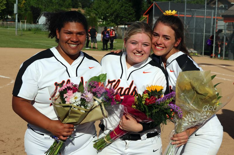 PMG PHOTO: JIM BESEDA - Gladstone recognized seniors (left to right) Madison Diggs, Kaleigh Noble, and Sabrina Ward after the Gladiators downed Molalla 11-1 Thursday to clinch the Tri-Valley Conference softball title.