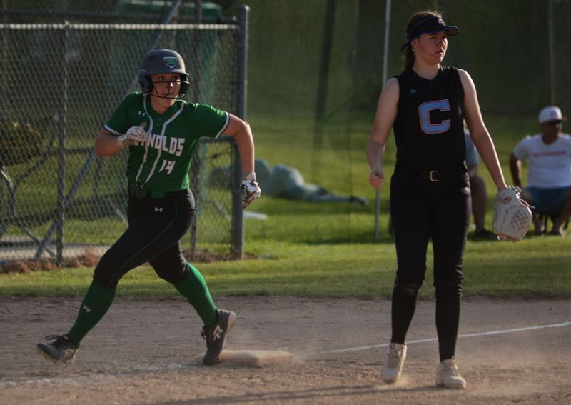 PMG PHOTO: DAVID BALL - Reynolds Adia Messenger rounds third base on her way to scoring to put the Raiders up 9-2 in the sixth inning Thursday.