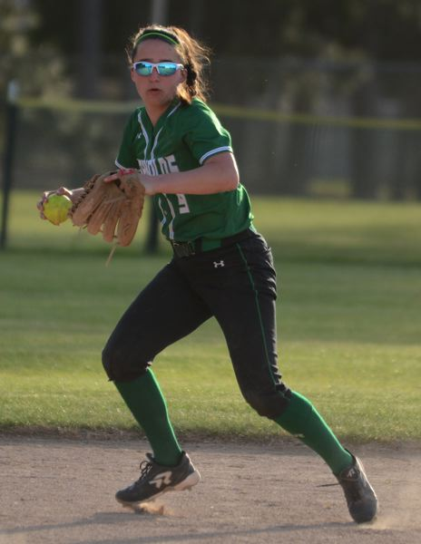 PMG PHOTO: DAVID BALL - Reynolds shortstop Kayley King prepares to make a throw across the infield for an out.