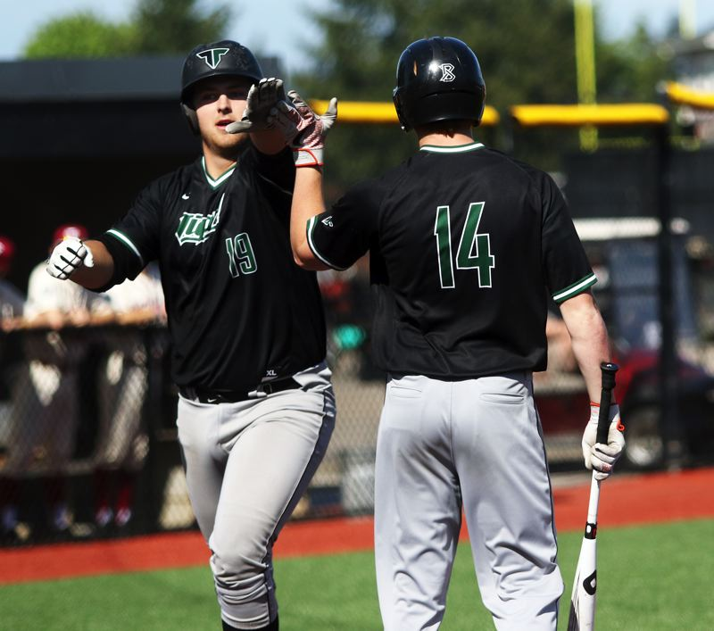 PMG PHOTO: DAN BROOD - Tigard High School senior C.J. Rivers (left) is congratulated by senior Fletcher Ahl after hitting the first of his two home runs in Wednesday's game at Tualatin.