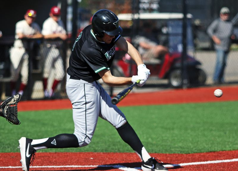 PMG PHOTO: DAN BROOD - Tigard High School senior Lance Kreisberg takes a swing during the Tigers' game at Tualatin on Wednesday.