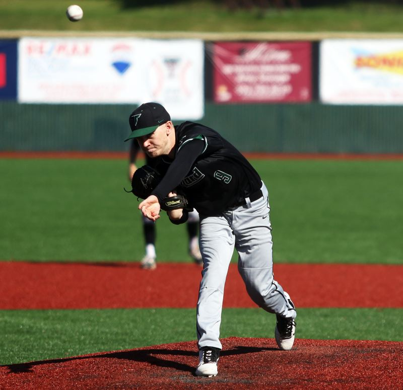 PMG PHOTO: DAN BROOD - Tigard High School senior Sam Gerkman throws a pitch during the Tigers' game at Tualatin on Wednesday.