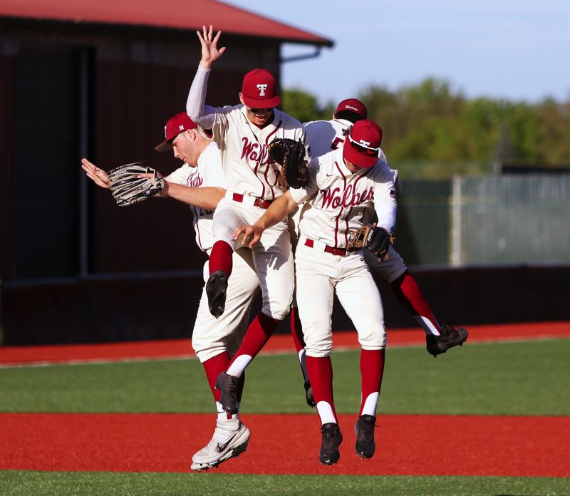 PMG PHOTO: DAN BROOD - Tualatin senior infielders (from left) Gavin Moore, Cameron Springer, Kyle Dernedde and Jett Searle celebrate following the Wolves' 5-2 win over Tigard.