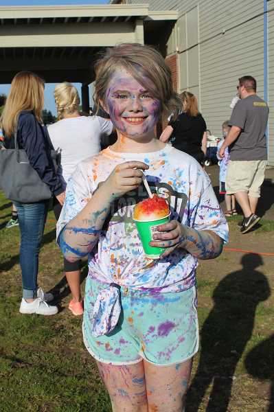KRISTEN WOHLERS - Grace Robinson enjoys a shaved ice after the event.