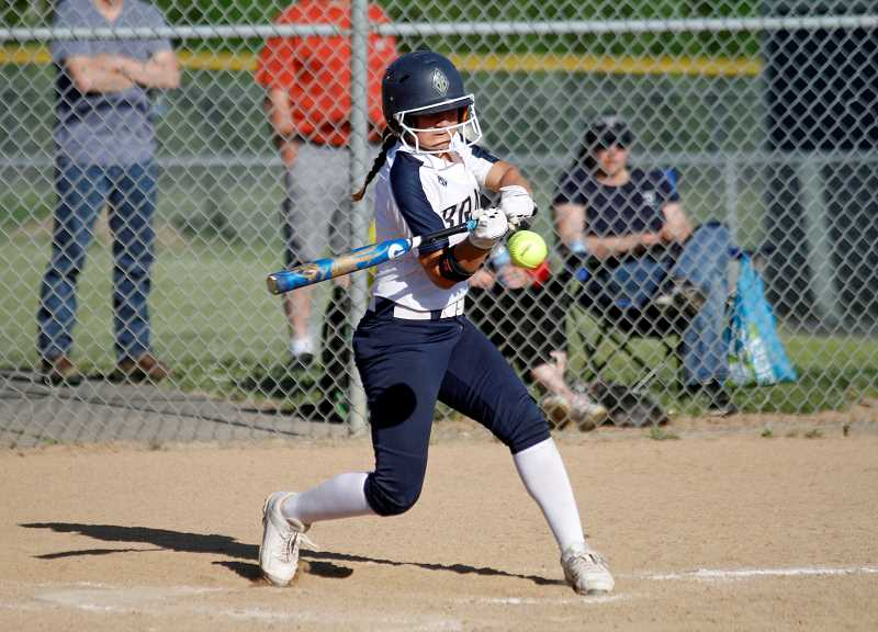 PMG PHOTO: WADE EVANSON - Banks' Halle Vandomelen takes a swing during the Braves' game against Tillamook Wednesday, May 8, at Banks High School.