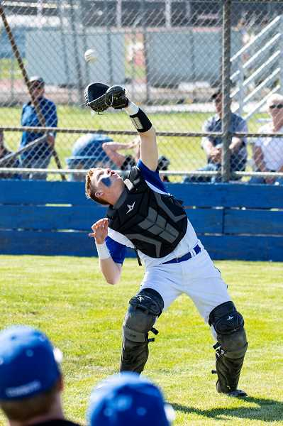 Crook County catcher Brody Connell catches a foul ball during the Cowboys' doubleheader with Ridgeview on Friday. Crook County won both games.