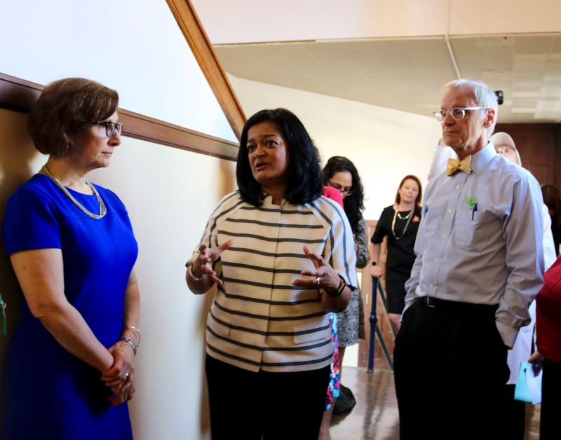 PMG PHOTO: ZANE SPARLING - Rep. Pramila Jayapal, center, speaks with reporters and Reps. Suzanne Bonamici, Earl Blumenauer during Medicare for All event at Benson High on Saturday, May 11 in Portland.