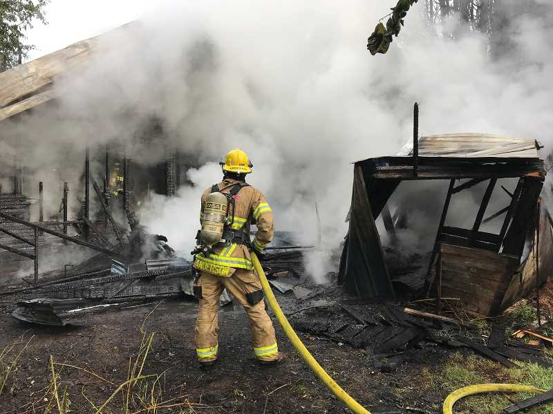 COURTESY PHOTO - Firefighters tackle a blaze on Filbert Street early Monday morning.