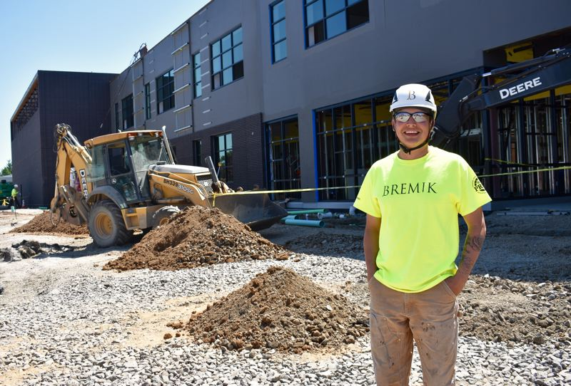PMG PHOTO: MATT DEBOW  - Foreman Eric Avila shows off one of the new safety helmets being used on the construction site at East Gresham Elementary School on Friday, May 10.