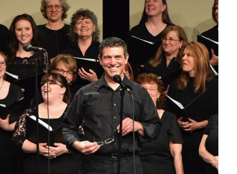 SUBMITTED PHOTO - John Baker leads the Tilikum Choir in a recent performance. He will take on the role of artistic director of the Portland Boychoir in August.
