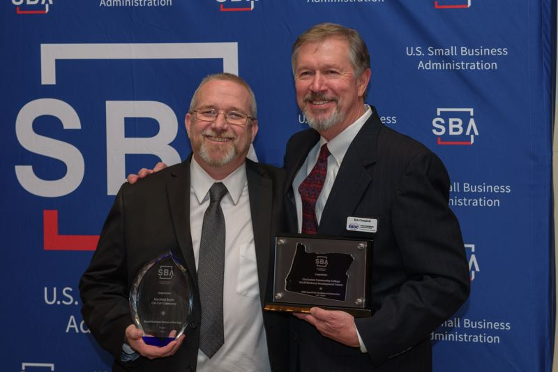 Marshall Doyle of Cal-Cert Co. and Rob Campbell of Clackamas Community College's Small Business Development Center are recognized at a May 2 awards ceremony at the Portland Art Museum as part of the celebration of National Small Business Week.
