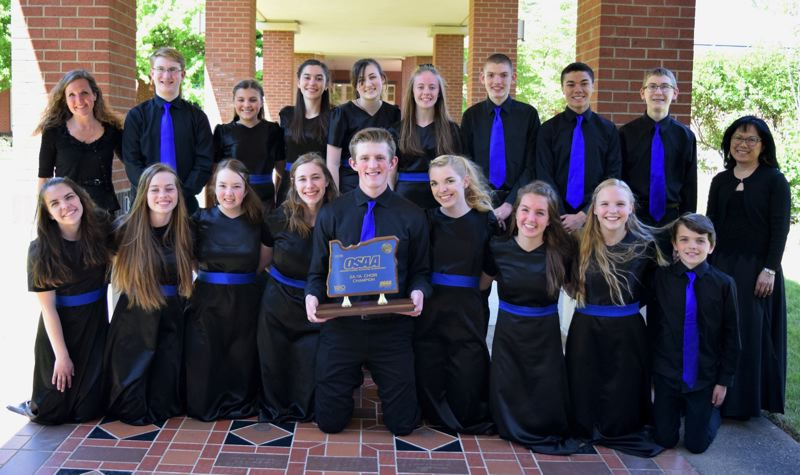 COURTESY PHOTO: JIM STEELE - Members of the choral group Excelsior -- (back row, left to right) director Rebecca Steele, Ethan Banister, Keiya Young, Raquel May, Dani Smith, Hannah Stark, Luke Van Sickle, Caleb Matias, Taylor Banister, accompanist Kelly Bard, (front row, left to right) Megan Hankland, Kaiah Gackle, Kira Birch, Lauren Brown, Hadden Stark, Natalie Sale, Breanna Steele, Ashlynn Kerekffy, and Tayler Hankland -- placed first at the OSAA Class 2A/1A high school choir state championships for the fourth year in a row.
