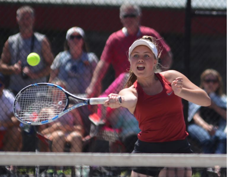 PMG PHOTO: DAVID BALL - Sandys Emma Donahue approaches the net to hit a volley during Thursdays doubles final.