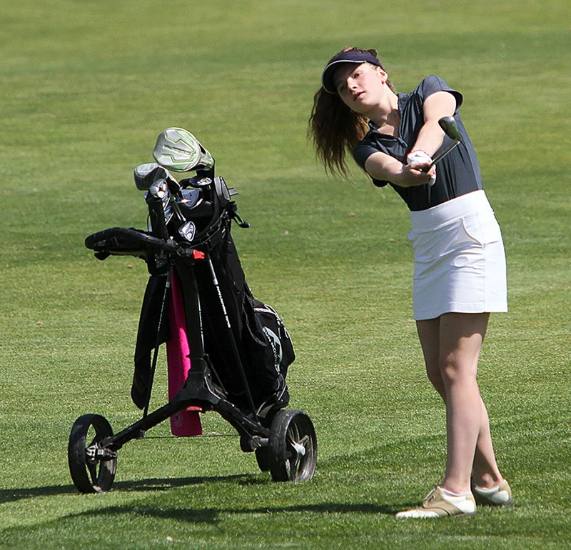 PMG PHOTO: DAVID BALL - Sandys Paige Dobson hits a fairway shot during the Special District 2 regional tournament at the OGA Golf Course in Woodburn last week.