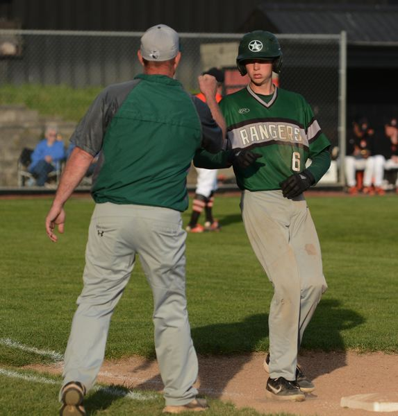 PMG PHOTO: DAVID BALL - Estacadas Nate Hagel arrives at first base with a hit.