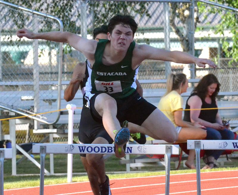 PMG PHOTO: TANNER RUSS - Estacadas Dakota Glover set a personal best on his way to third place in the 300-meter hurdles.