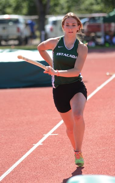 PMG PHOTO: DAVID BALL - Estacadas Julia Griffith moves down the runway during her second-place finish in the pole vault.