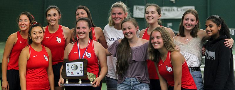 PMG PHOTO: MILES VANCE - The Lake Oswego girls tennis team poses with its first-place trophy after winning the Three Rivers League district tournament at Portland Tennis Center on Friday, May 10.