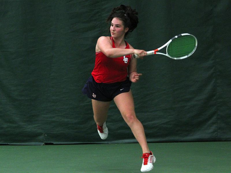 PMG PHOTO: MILES VANCE - Lake Oswego sophomore Mariam Nechiporuk smashes a return during her win at first singles on Friday, May 10, in the Three Rivers League district tournament at Portland Tennis Center.