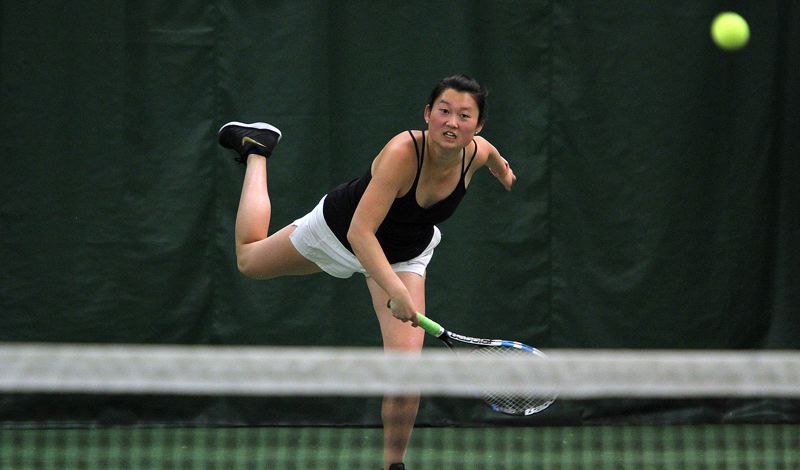 PMG PHOTO: MILES VANCE - Lakeridge senior Gigi Davies hits a serve during her win at first doubles on Friday, May 10, in the Three Rivers League district tournament at Portland Tennis Center.