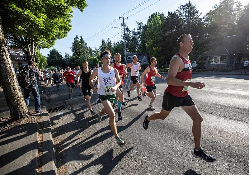 PMG PHOTO: JONATHAN HOUSE - Racers fly by during the Lake Oswego Lake Run.