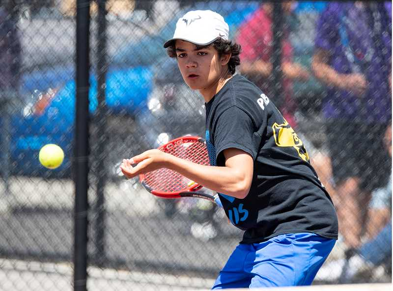 LON AUSTIN/CENTRAL OREGONIAN - Pablo Casado prepares to play a shot during Friday's opening day of the Intermountain Conference Tennis Championships. Casado finished second to Breaden Brooks of Redmond, earning a trip to this weekend's state tournament.