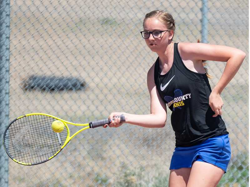 LON AUSTIN/CENTRAL OREGONIAN - Gracie Slawter plays a shot during the district tennis championships, which were held at Ridgeview High School Friday and Saturday.