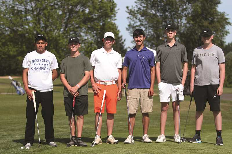 PMG PHOTO: PHIL HAWKINS - After winning the first district title in program history, the Woodburn boys golf team is setting its sights on a top-four finish at the state championship this week.