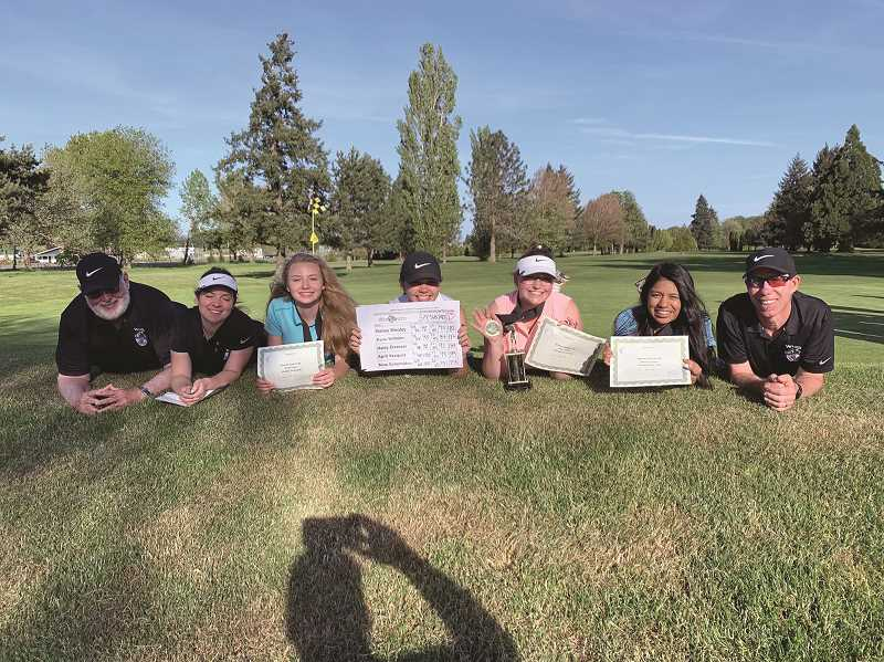 COURTESY PHOTO: WOODBURN GIRLS GOLF - The regional champion Woodburn girls golf team — Haley Elsasser, Paris Wilhelm, Nina Scherbakov, Bailey Woolley and April Vasquez — bracketed by coaches Bill Mickel (far left) and Neil Wilhelm.