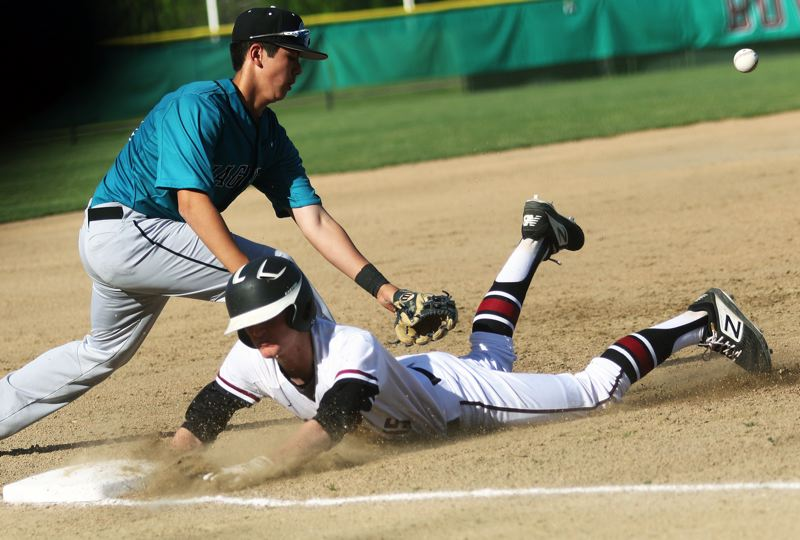 PMG PHOTO: DAN BROOD - Sherwood High School sophomore Jackson Hannan dives safely to third base as Century freshman Niko Rosell reaches for the ball during Thursday's Pacific Conference game.