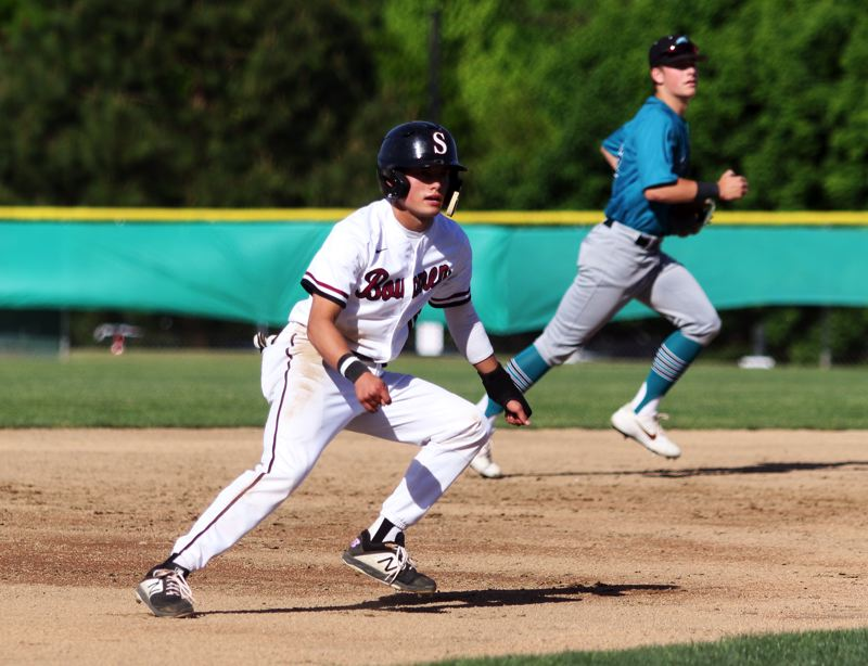 PMG PHOTO: DAN BROOD - Sherwood High School senior Anthony Garrett looks to make a move between second and third base during the Bowmen's home game with Century.