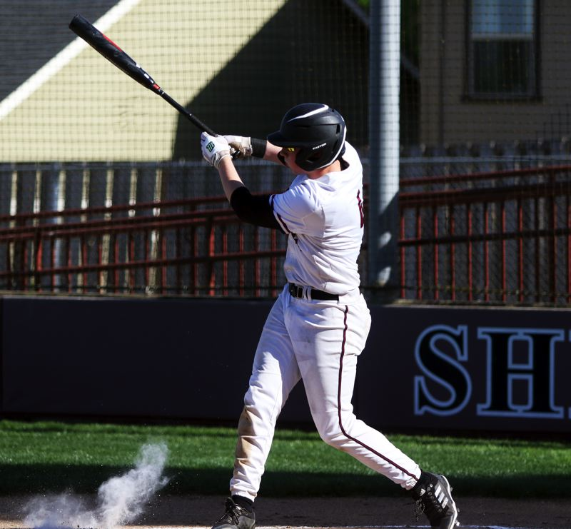 PMG PHOTO: DAN BROOD - Sherwood High School freshman Ian Umlandt takes a swing during the Bowmen's 4-3 loss to Century in Thursday's Pacific Conference game.