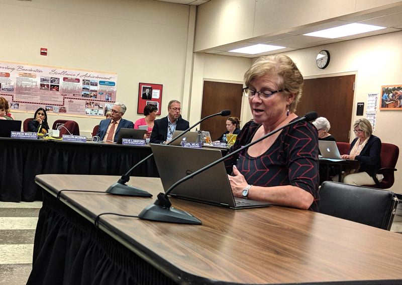 PMG PHOTO: COURTNEY VAUGHN - Gayellyn Jacobson gives a financial update during a Beaverton School District board meeting April 29. Jacobson, the district's chief financial officer, tendered her resignation on May 8.