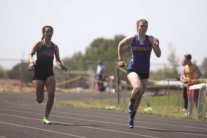 PMG PHOTO: PHIL HAWKINS - Gervais sophomore Katie Hanson (right), returns to the state meet in the 400 and will make her state debut in the 800 and triple jump.