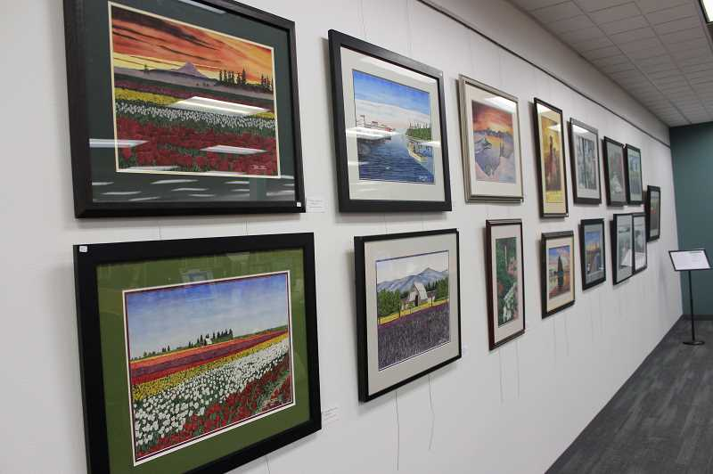 PMG PHOTO: COREY BUCHANAN - Brad Isom depicts many Pacific Northwest landscapes in his exhibit at the library.