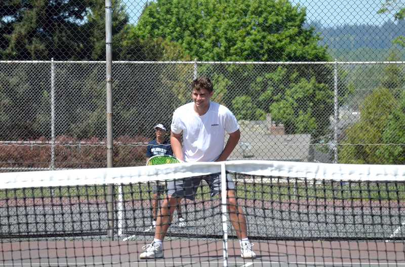 PMG PHOTO: TANNER RUSS - Wilsonville senior Jack Roche ended his Northwest Oregon Conference tennis career as a district champion.