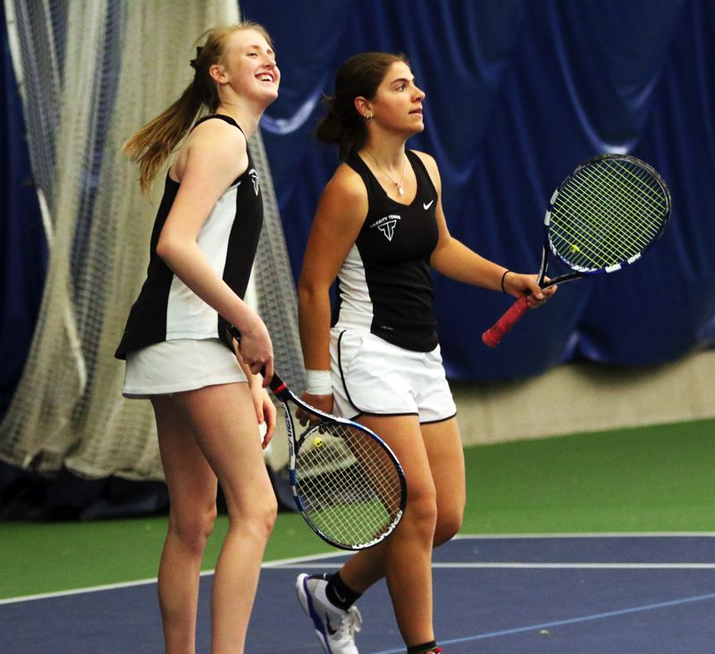 PMG PHOTO: DAN BROOD - Tigard sophomore Ali Dreves (left) and senior Nicole Mazzeo worked together well as a team in doubles play at the Three Rivers League district tennis tournament.