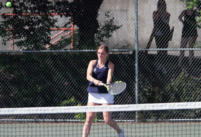 PMG PHOTO: MILES VANCE - Canby senior Lillian Lockwood picked up a win with doubles partner Amanda Davis over Oregon City's Lee and Li at the TRL district meet.