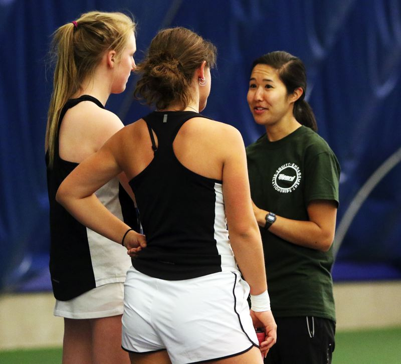 PMG PHOTO: DAN BROOD - Tigard's Ali Dreves (left) and Nicole Mazzeo talk to Tiger coach Kelsey Wahl during a break in play at Friday's Three Rivers League district tournament semifinals.