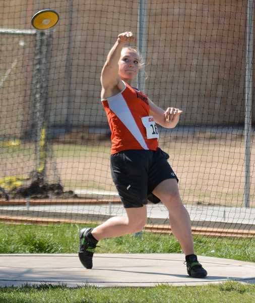 PMG PHOTOS: JIM BESEDA  - Senior Katie Sandberg claimed second in the discus, and will participate in the javelin and shot put as well at the state track meet
